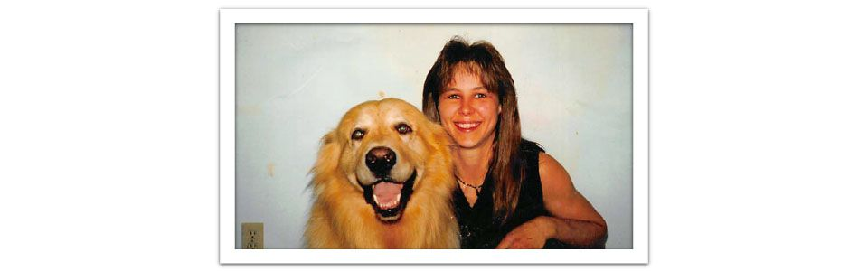 Pet owner with golden retriever